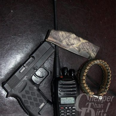 Diamondback DB9, Baofeng radio, paracord braclet and pocket knife