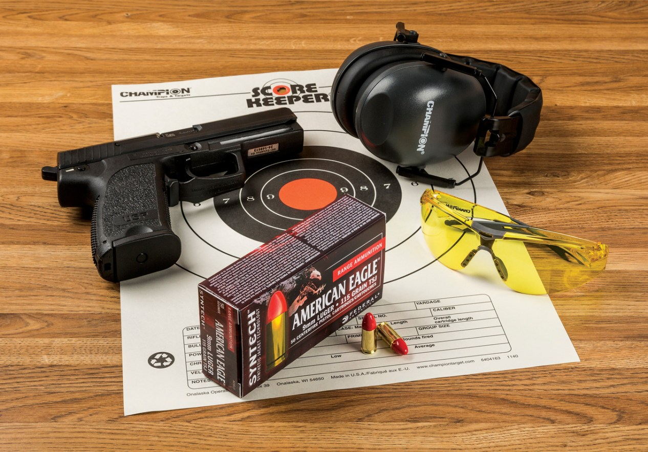 9mm Syntech ammunition in front of shooting glasses and earmuffs