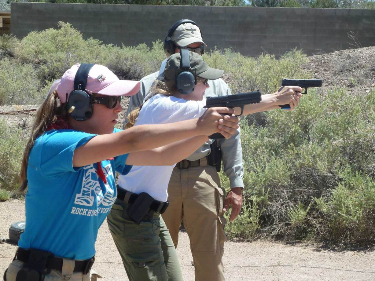 Women shooting handguns at Gunsite.