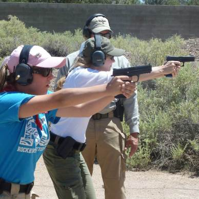 Women shooting handguns at Gunsite.