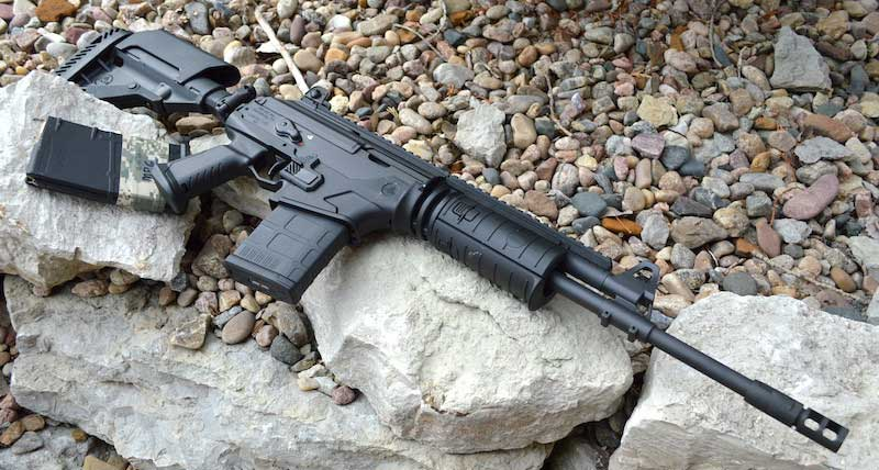 Galil Ace .308 rifle right with spare magazine laying on a bed of rocks