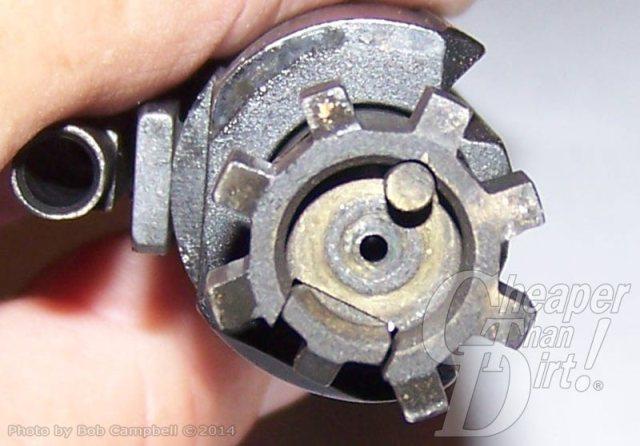 Silver AR-15 with focus on bolt head