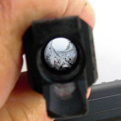 Inside of a gun barrel showing the rifling