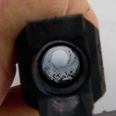 REar view of a pistol barrel showing unburnt powder