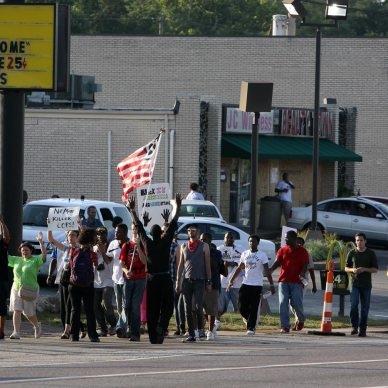 Picture shows a group of protestors in Ferguson, Missouri.