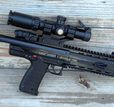 Kel-Tec CMR 30 rifle right with wood background
