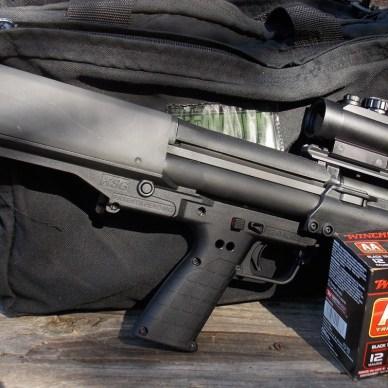 Kel-Tec KSG shotgun with a box of Winchester AA Shotshells