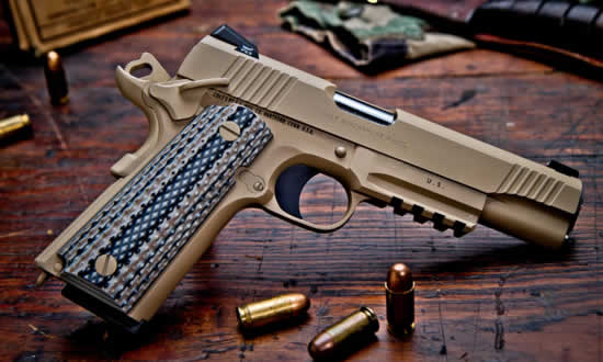 Desert tan Colt 1911 pistol with wood grips