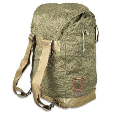 Picture shows the back of a military surplus backpack with brown vinyl bottom in Polish puma camo.