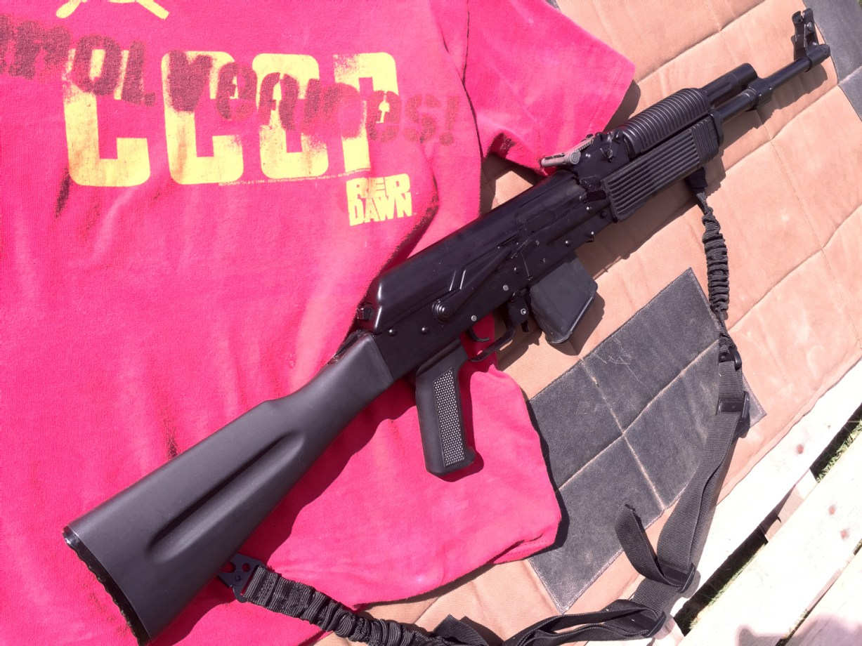 right profile of an AK-47 on a red t-sirt