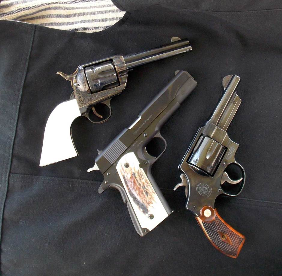 Two revolver reproductions with a 1911 pistol