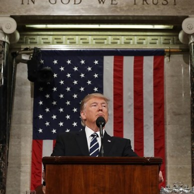 President Donald J. Trump standing at a podium in front of the American flag