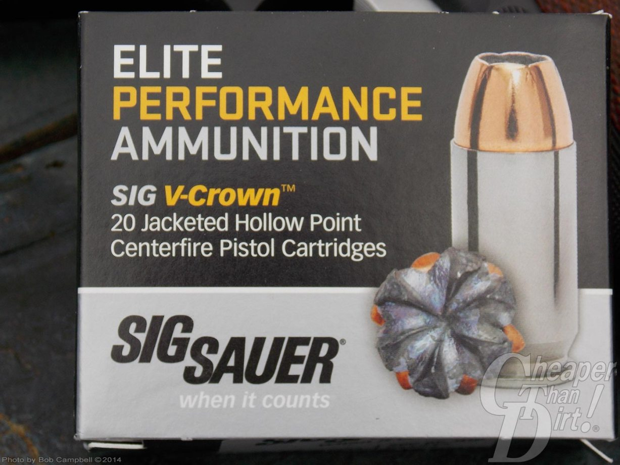 Silver-and-black box of SIG ELITE Performance ammunition with white and gold lettering