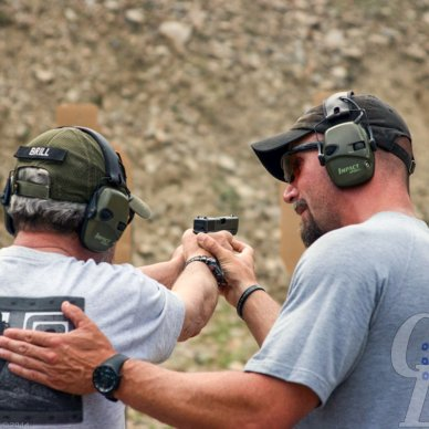 Mike Seekander teaches a student the right way to improve shooting skills.