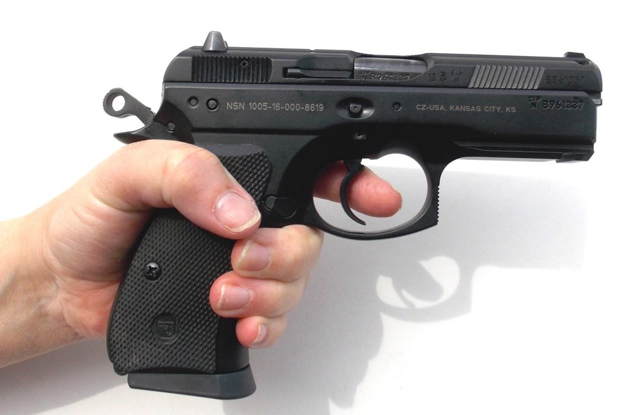 demonstrating the proper trigger press of a pistol