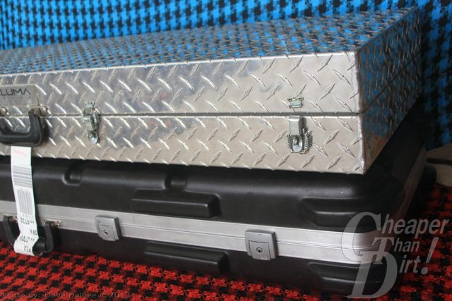 Aluma case stacked on top of SKB case