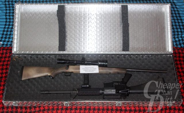 Aluma rifle and bow case with two long guns.
