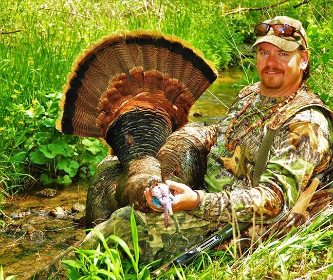 Hunter posing with turkey