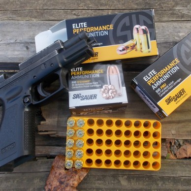 Springfield XD pistol with three boxes of SIG Sauer ammunition