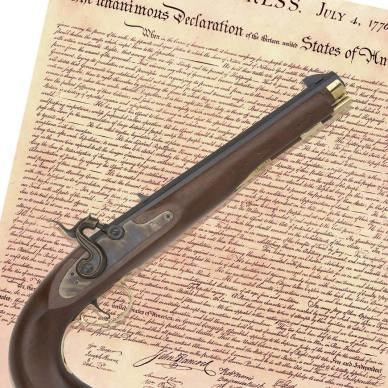 Declaration of Independence with a muzzle loading pistol on top