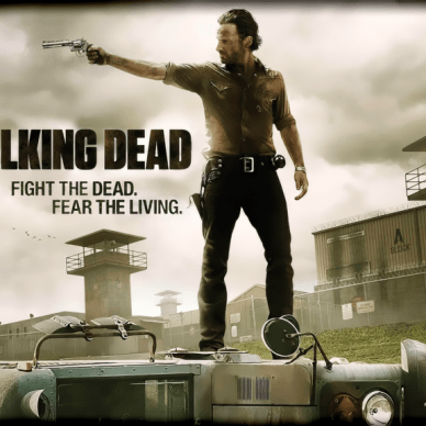 Picture shows a character from the show, The Walking Dead on top of a car pointing a pistol.