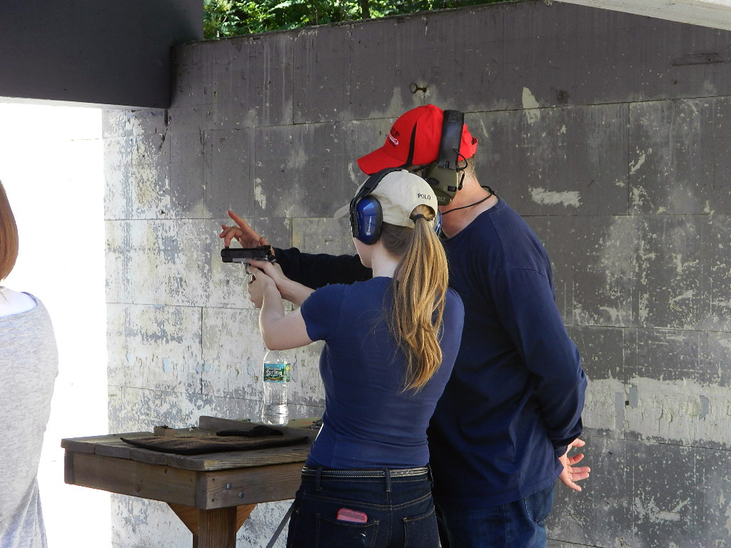 Teenager shooting targets at the gun range