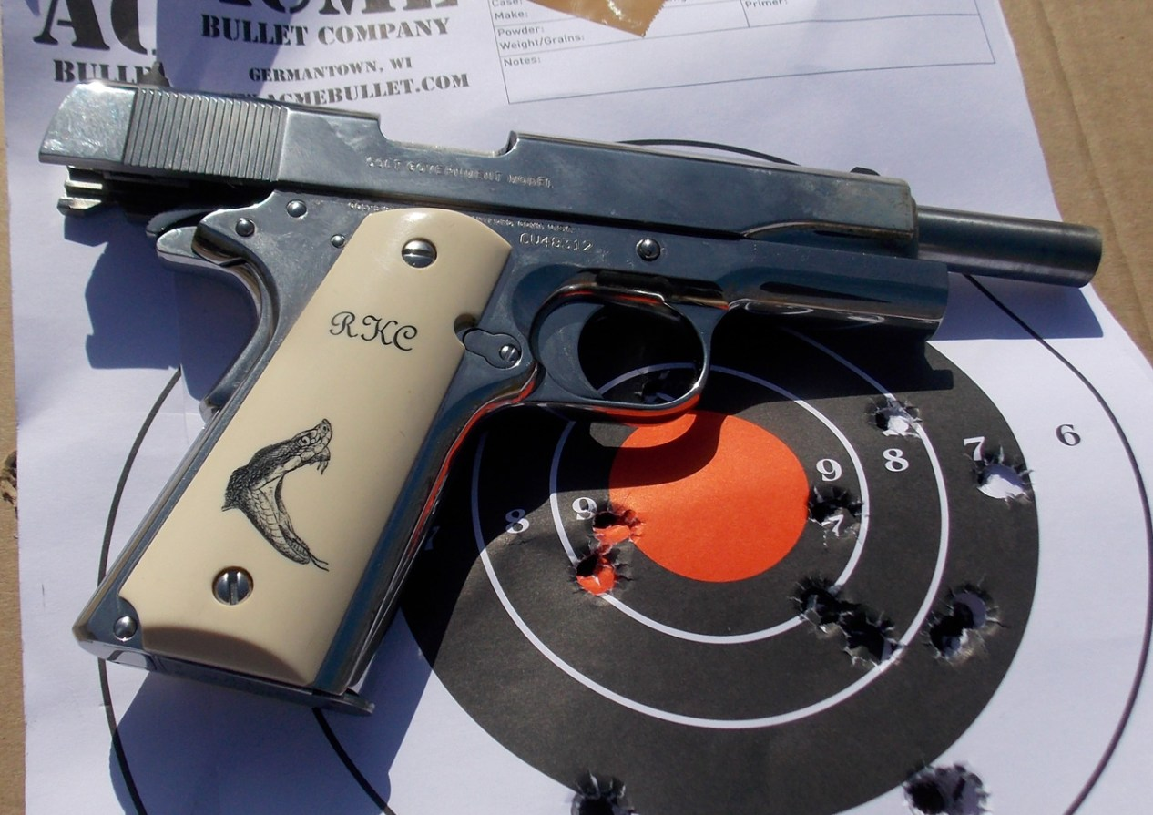 Colt Stainless 1911 with target shot at 25 yards