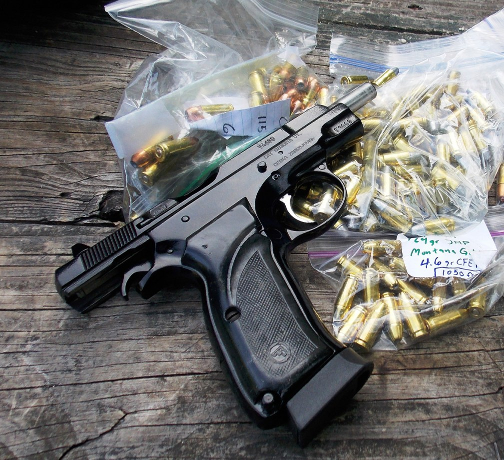 CZ 75 pistol with a Ziplock bag of handloaded bullets