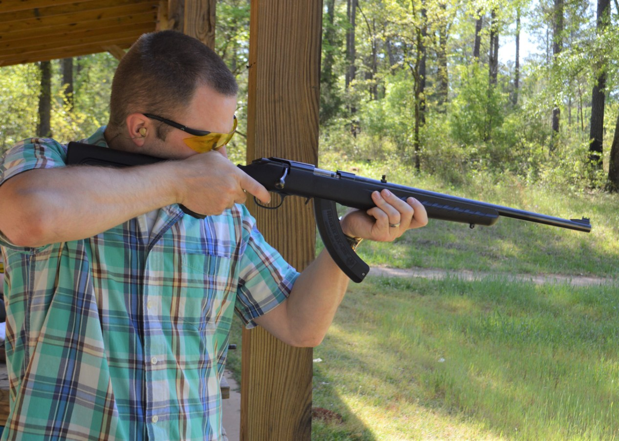 Man shooting the Ruger American Rimfire rifle