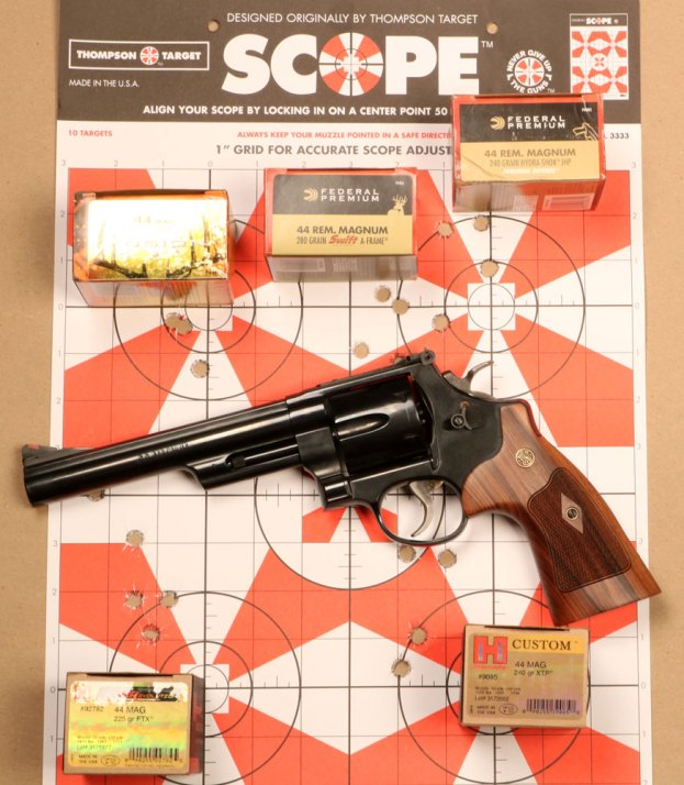 Smith and Wesson Model 29 with multiple boxes of ammunition and target