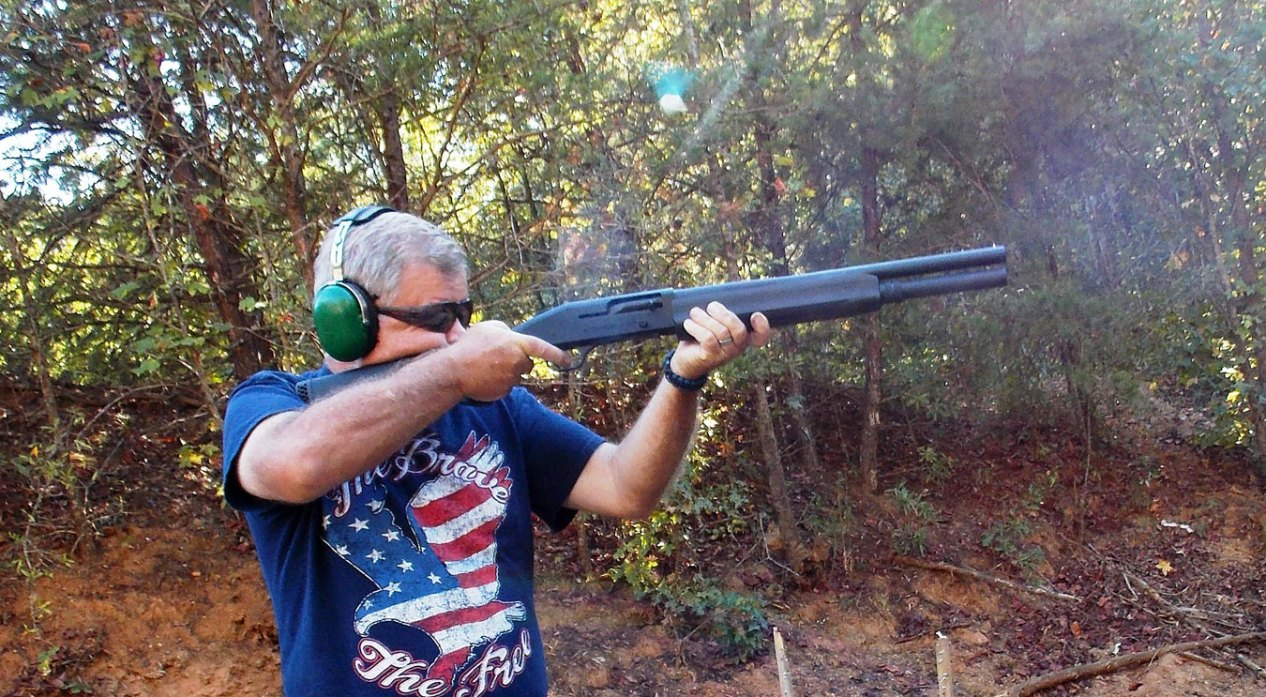 Bob Campbell shooting a shotgun through recoil