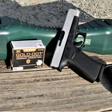 Glock 48 pistol two tone with Gold Dot ammunition box