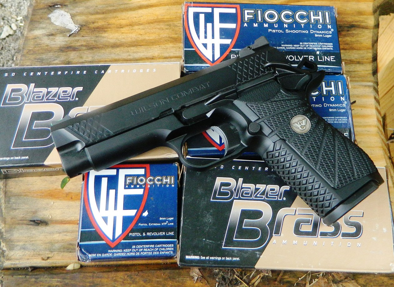 Wilson Combat 9mm 1911 pistol atop several boxes of Fiocchi ammunition