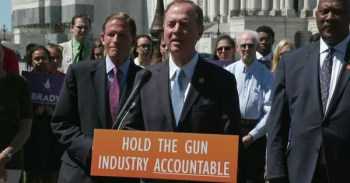 Adam Schiff talking at a podium about the PLCAA
