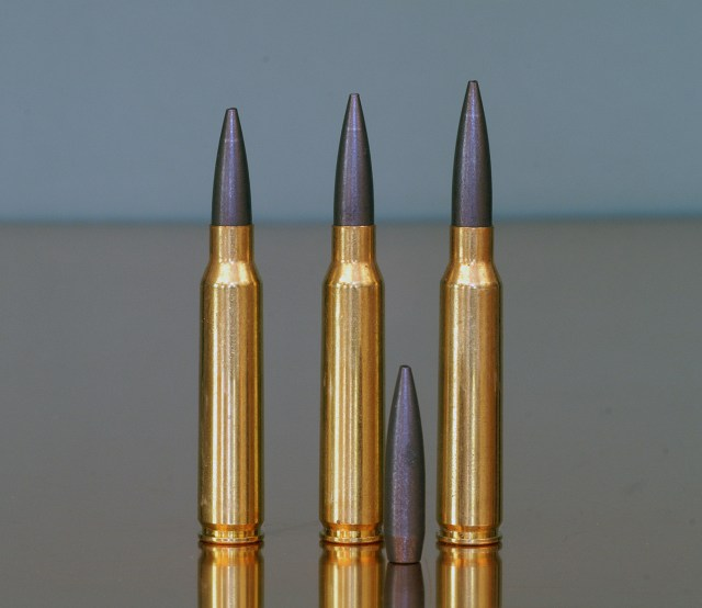 Three .223 5.56mm cartridges with Sierra Matchking bullets seated to different depths