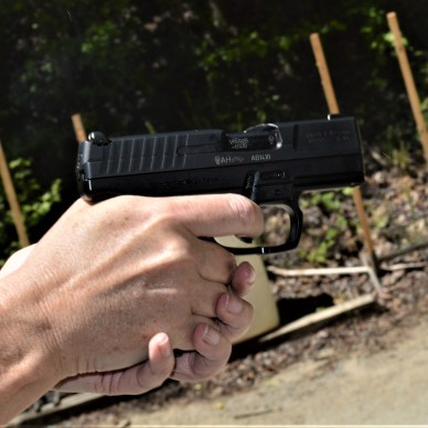 Woman's hands holding a Walther PPS pistol