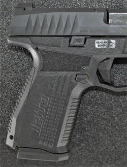 Texture on the grip of the Arex Rex Delta pistol