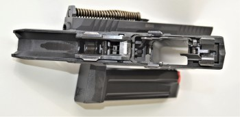 Field stripped Arex Rex Delta pistol