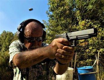 Bob Campbell shooting a pistol offhand