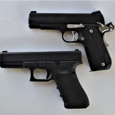 Hammer-fired and striker-fired handguns - side view