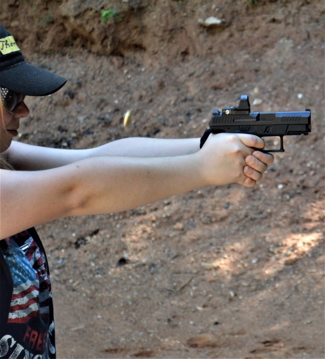 9mm female shooter in action - personal defense tips