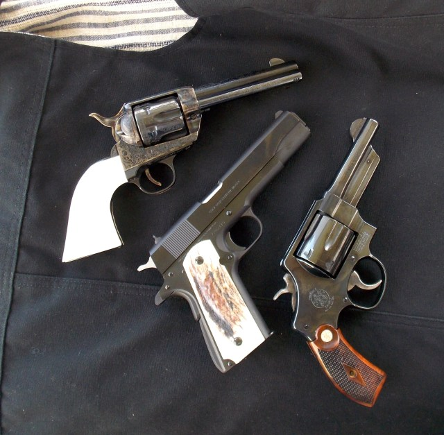 three handguns, two revolvers and a pistol guns for hiking