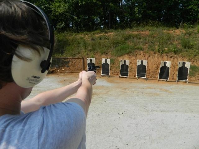 Shooting revolver at string of targets
