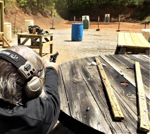 Man firing revolver