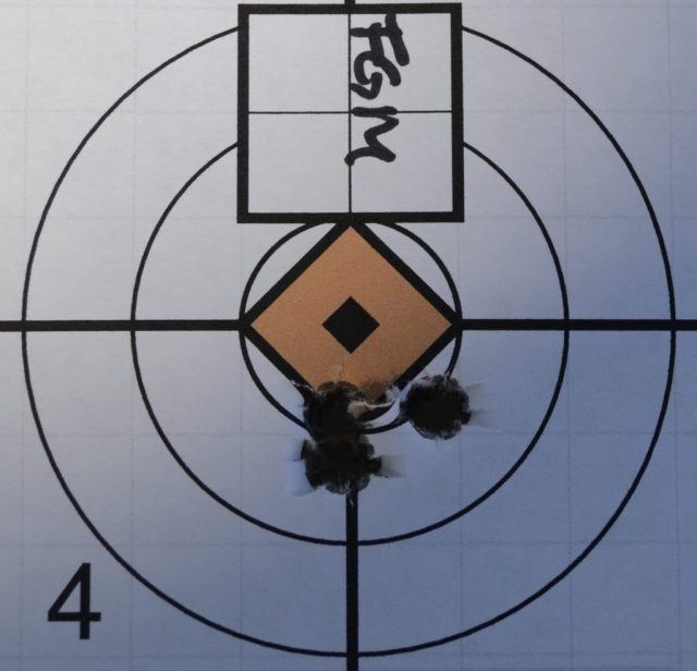 Small bullet group on paper target