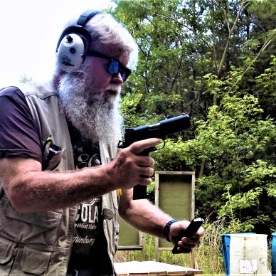 Man reloading handgun practical drills