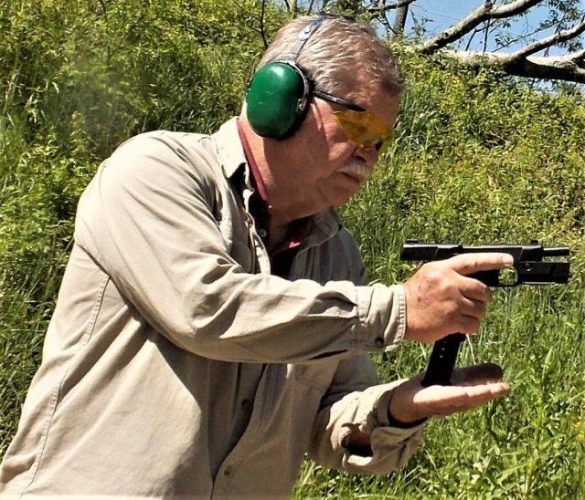 man reloading handgun
