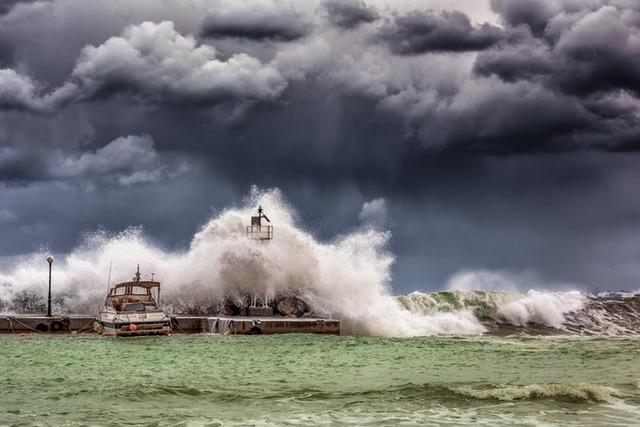 waves and storm crashing boats