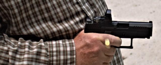 Man Firing Handgun from Retention