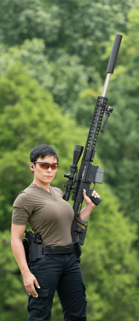 woman holding large AR rifle